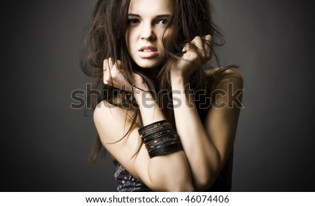 Portrait of a beautiful young woman with dark hair