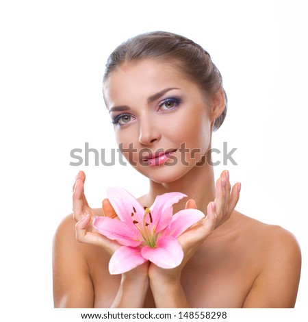Portrait of a beautiful young woman with flower lily in her hand over white background