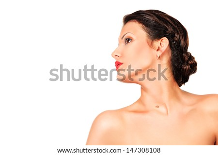 Portrait of a beautiful young woman with fresh daily makeup. Isolated over white.