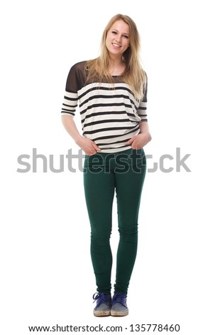 Portrait of a beautiful young woman with hands in pockets - full length - stock photo