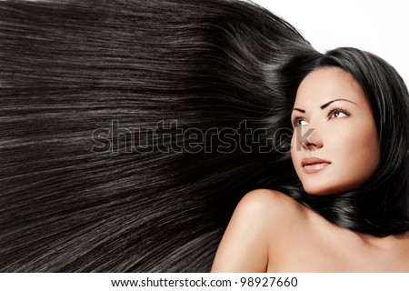 portrait of a beautiful young woman with healthy long brunette hair - stock photo