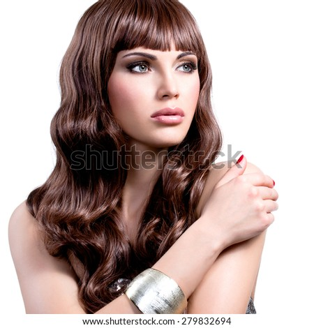 Portrait of a beautiful young woman with long brown hairs.  - stock photo