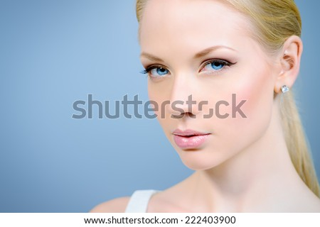 Portrait of a beautiful young woman with natural make-up and blonde hair. Beauty, Healthcare.