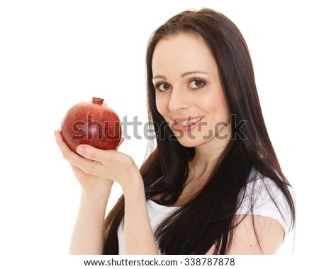 Portrait of a beautiful  young woman with pomegranate on a white background. - stock photo
