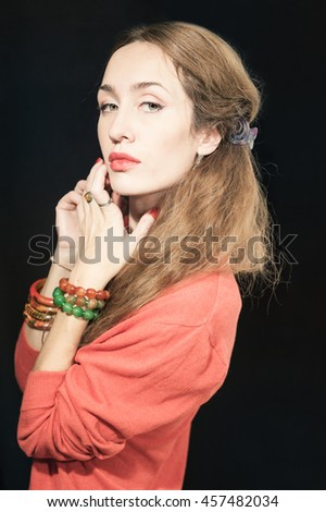 Portrait of a beautiful young woman with red manicure closeup - stock photo