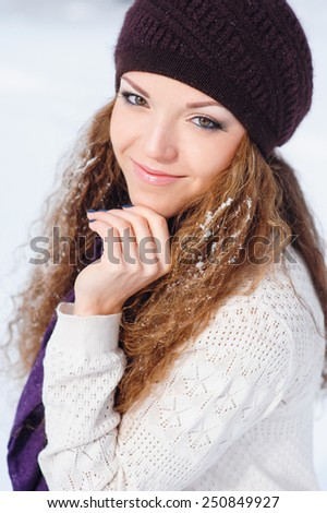 portrait of a beautiful young woman with snow on her hair.