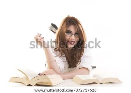 Portrait Of A Beautifull Smiling Young Woman With Books Lying On Floor