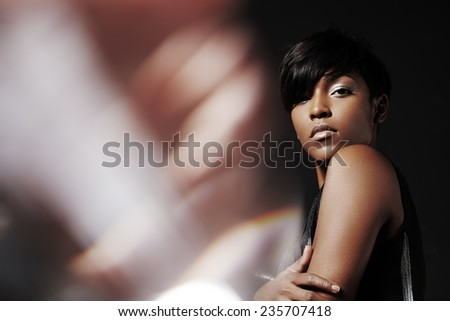 portrait of a beauty black woman with a flair on the left side - stock photo
