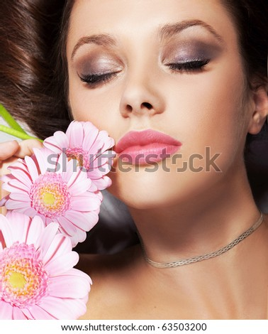 Portrait of a beauty lady with flowers - stock photo