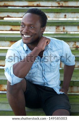 Portrait of a black man smiling outdoors