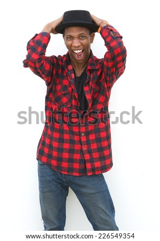 Portrait of a black man with hat shouting  - stock photo