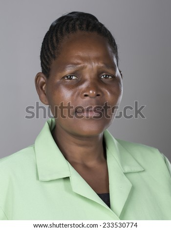 Portrait of a black middle aged woman making facial expressons and emotions - stock photo
