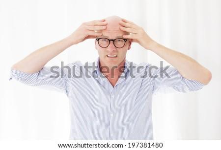portrait of a blad man with a headache - stock photo
