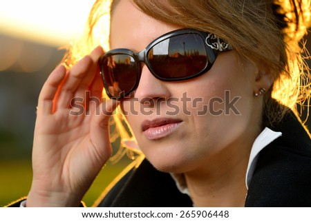 portrait of a blond girl with sunglasses - stock photo
