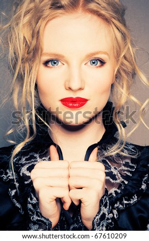 Portrait of a blond lady with a beautiful hair and red lips - stock photo