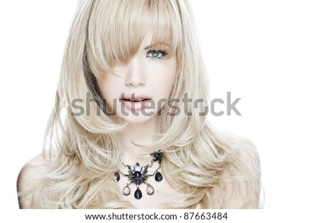 portrait of a blond woman in studio - stock photo