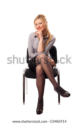 Portrait of a blonde businesswoman sitting in a chair, isolated on white background