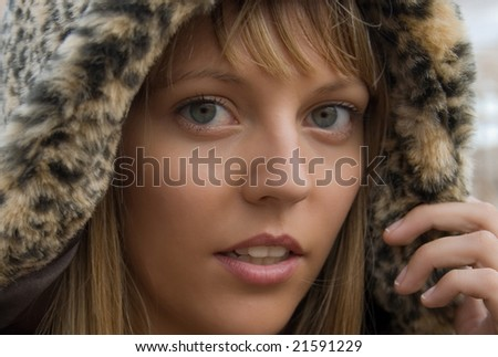portrait of a blonde woman with beautiful eyes - stock photo