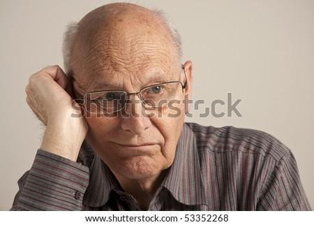 Portrait of a bored senior man - stock photo