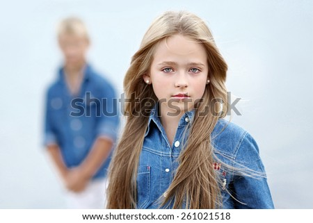 Portrait of a boy and girl on the beach in summer - stock photo