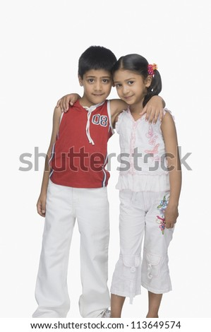 Portrait of a boy and his sister arm around - stock photo