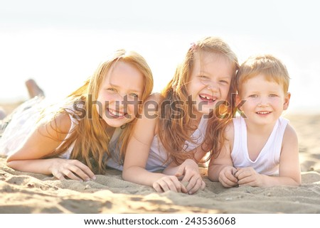 Portrait of a boy and his two sisters loved - stock photo