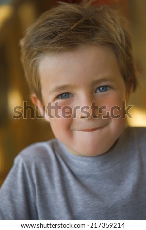 Portrait of a boy biting his lip - stock photo