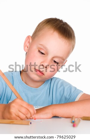 portrait of a boy drawing at table