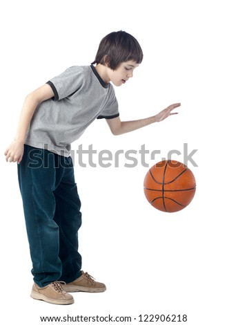 Portrait of a boy dribbling a basketball