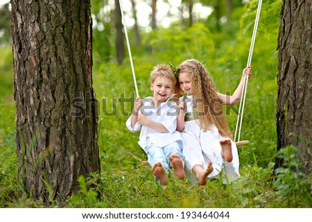 Portrait of a boy girl in a summer forest - stock photo