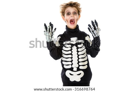 Portrait of a boy in a costume of skeleton. Halloween party. Isolated over white. - stock photo