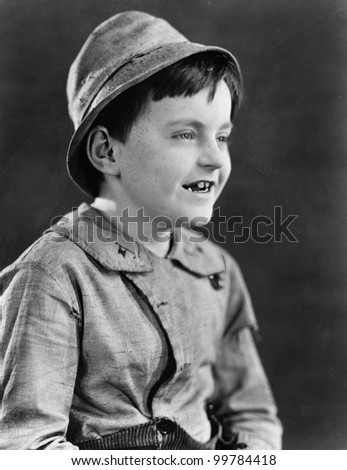 Portrait of a boy in a hat and grinning - stock photo