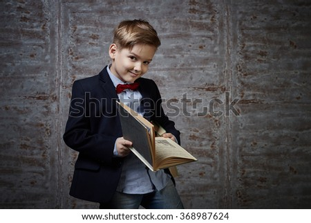 Portrait of a boy in a suit in the studio. Childhood, child, portrait. - stock photo