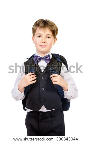 Portrait of a boy in a suit standing with schoolbag. Fashion kids. Education. Isolated over white.