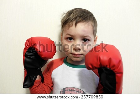 Portrait of a boy in boxing gloves