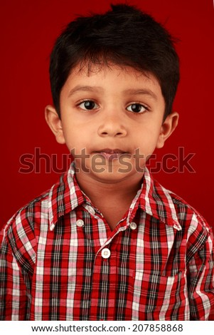 Portrait of a boy in red background - stock photo