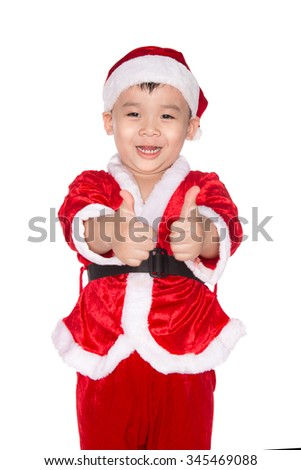 Portrait of a boy in red christmas hat doing the okay gesture