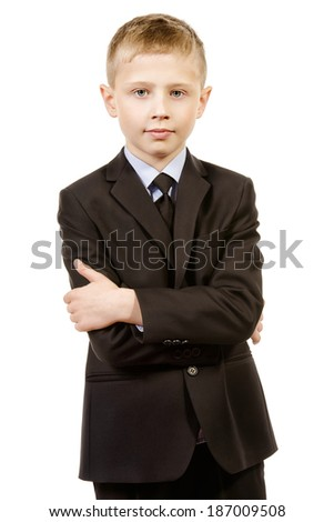 Portrait of a boy in school uniform. Isolated over white. - stock photo