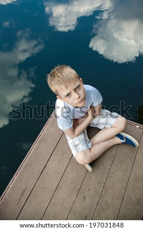 Portrait of a boy in the cloud - stock photo