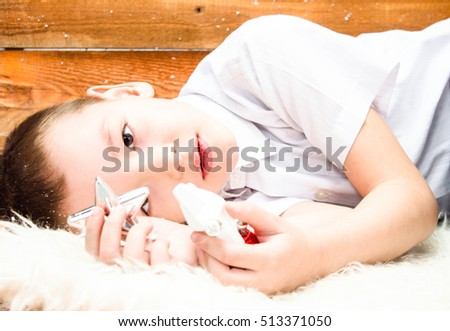 Portrait of a boy lying on the floor at Christmas