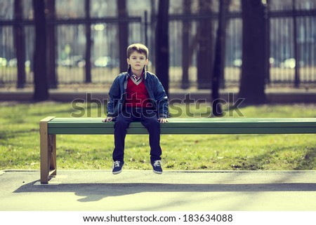 Portrait of a boy on a walk in the park