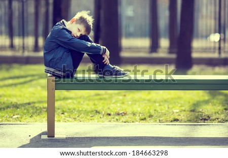 Portrait of a boy on a walk in the park - stock photo
