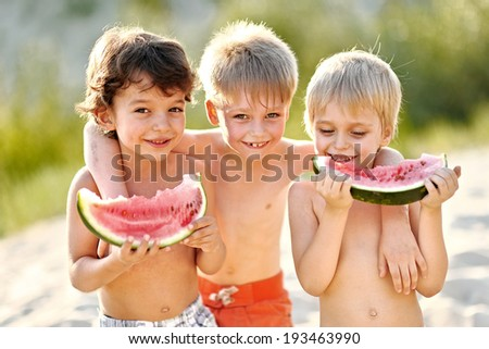 Portrait of a boy on the beach in summer - stock photo