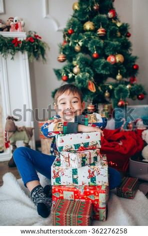 portrait of a boy playing near the Christmas tree