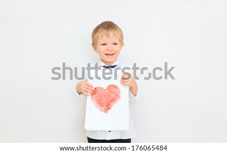 portrait of a boy presenting picture of heart - stock photo