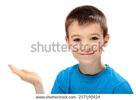 Portrait of a boy presenting something on his hand on white background - stock photo