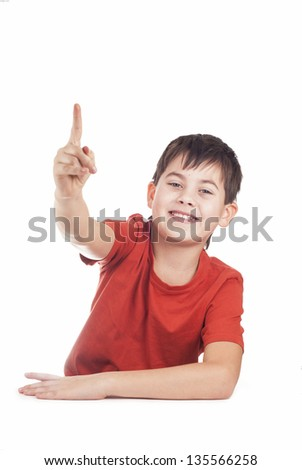 Portrait of a boy raising his arms against a white background - stock photo