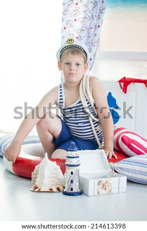 Portrait of a boy sailor playing in his room
