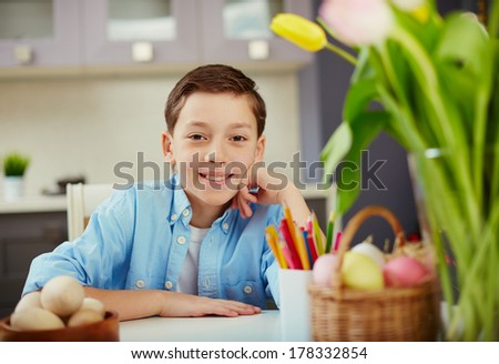 Portrait of a boy sitting at table at Easter Day - stock photo