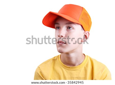 Portrait of a boy wearing an orange hunting hat, on a white background. - stock photo